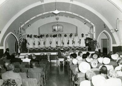 101-historic_87-b_w-photo-of-choir-singing-at-sermon-min