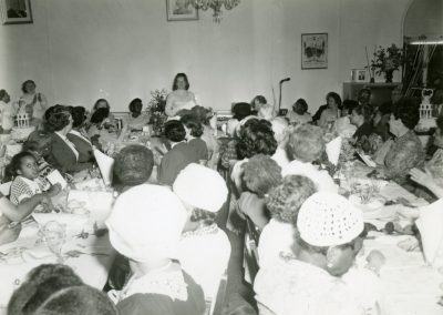 94-historic_80-b_w-photo-of-woman-speaking-at-a-function-min