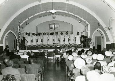 101-historic_87-b_w-photo-of-choir-singing-at-sermon-min