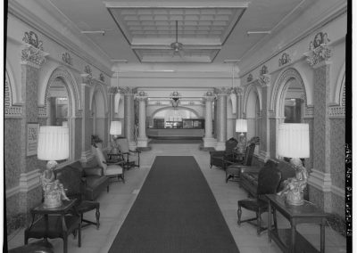 24-historic_13-b_w-view-of-lobby-with-food-counter-at-the-end-min
