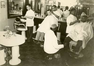 78-historic_64-men-getting-shaved-and-haircuts-in-the-hair-salon_-min