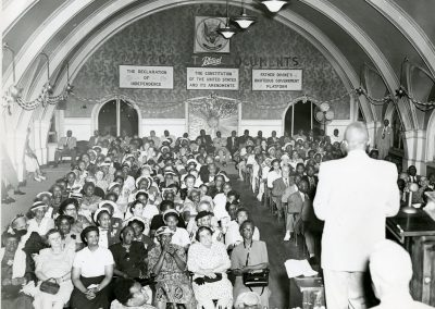 82-historic_68-b_w-photo-of-a-sermon-or-speaking-function-min