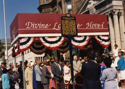 89-historic_75-close-up-color-right-angle-photo-of-front-enterance-including-father-divine-historic-signage-min